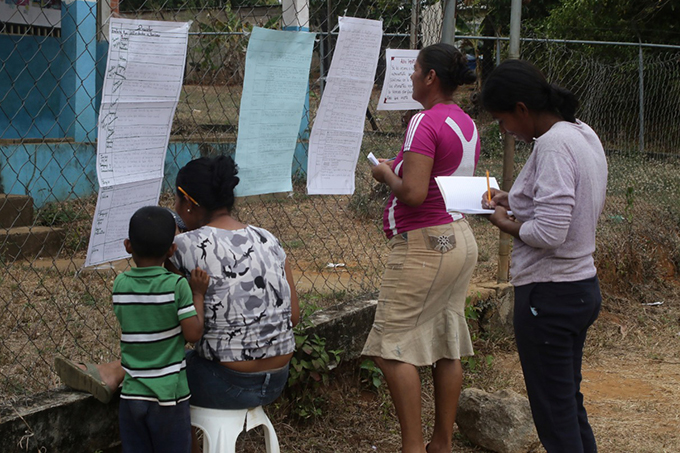 Parents collecting homework for their kids Nicaragua photo